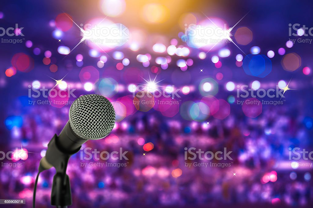 Close up microphone  on stage in concert hall. stock photo