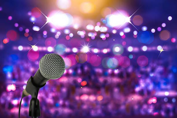 close up microphone  on stage in concert hall. - stage musical stock-fotos und bilder