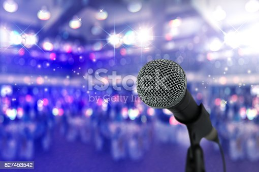 istock Close up microphone  on stage in concert hall. 827453542