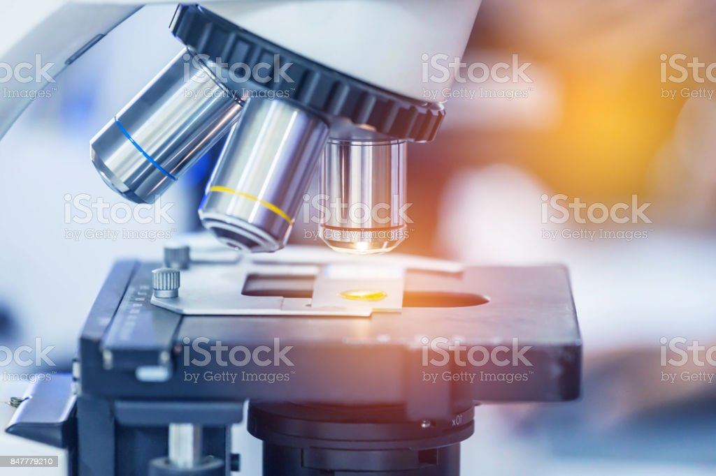 close up microscope equipment for research experiments stock photo
