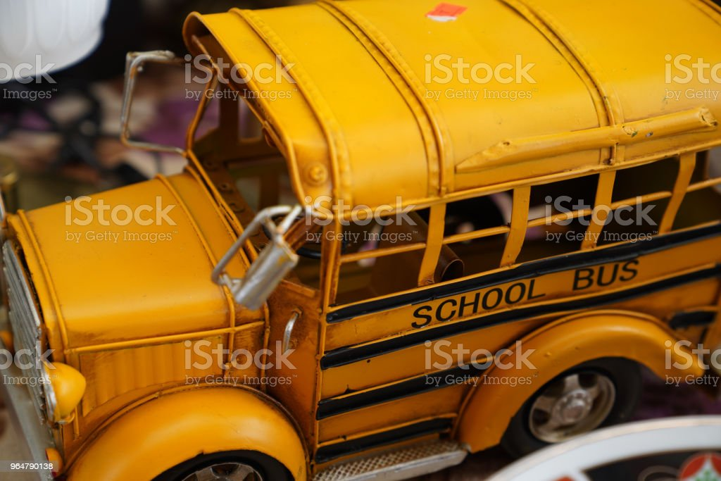 Close up miniature metal toy yellow school bus royalty-free stock photo