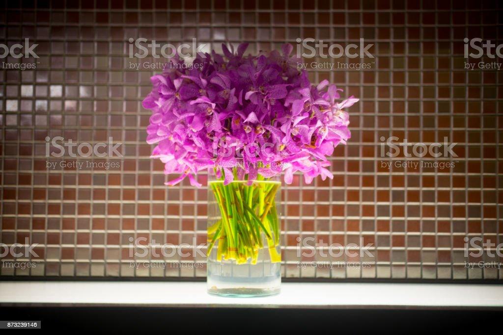 Close up mokara boonlong orchid flower bouquet in glass pot stock photo