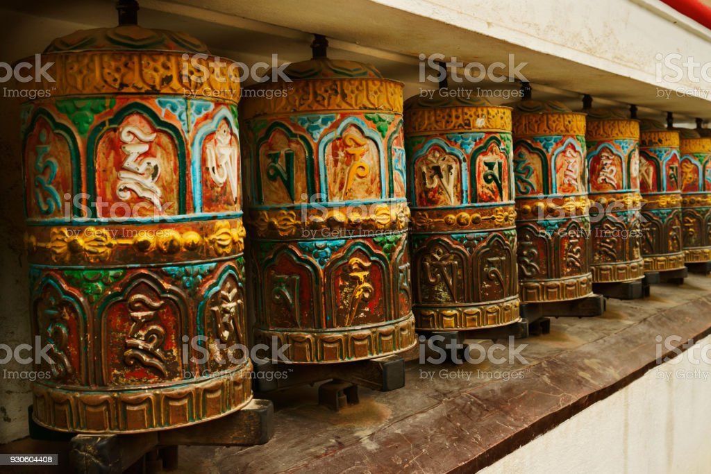 close up nepalese buddhistic prayer wheels at temple stock photo