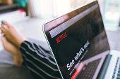 Close up Netflix website in laptop screen. Netflix being popular internationally.