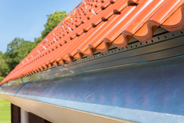 Close up new gutter with roof tiles stock photo