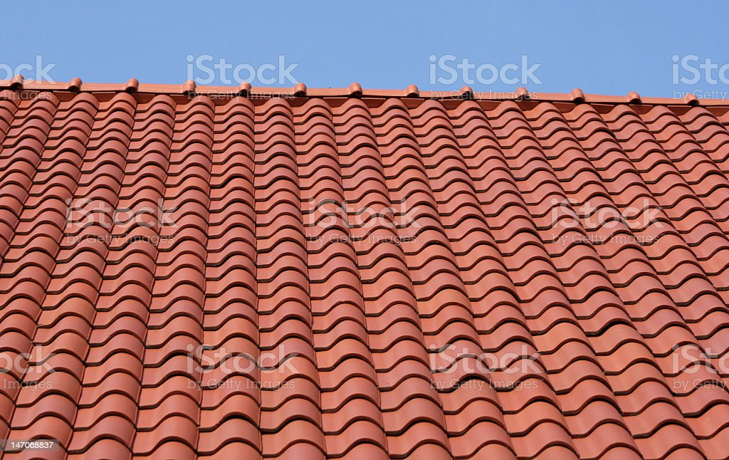 Close up new terracotta tiled roof stock photo