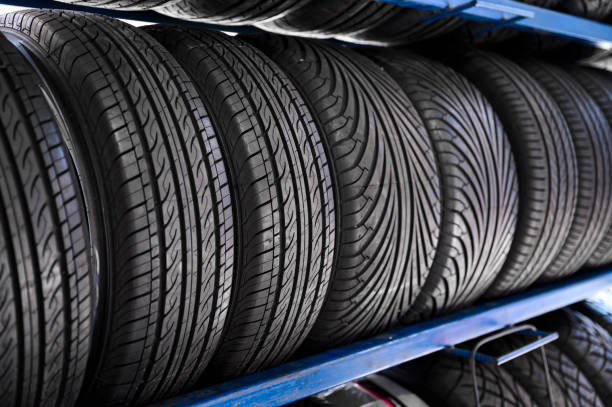 Close up new tyres on shelve in tire shop stock photo