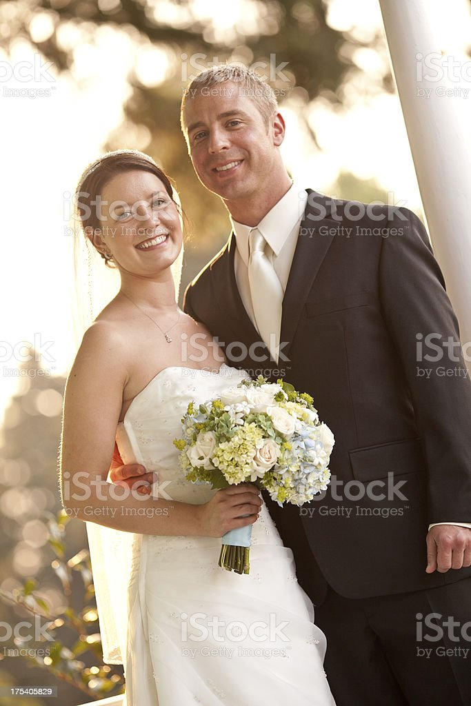 Close Up Newlyweds On Country House Porch Wooded Background Smiling stock photo