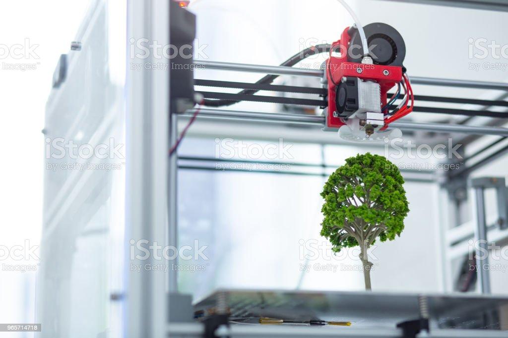 Close up of 3D printer creating tree model - Royalty-free 3D Printing Stock Photo