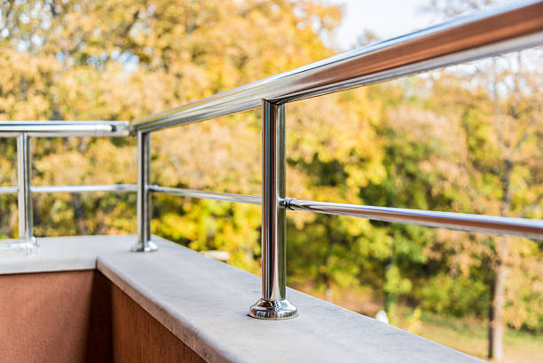 Close up of a balcony metal balustrade. Autumn background. stock photo