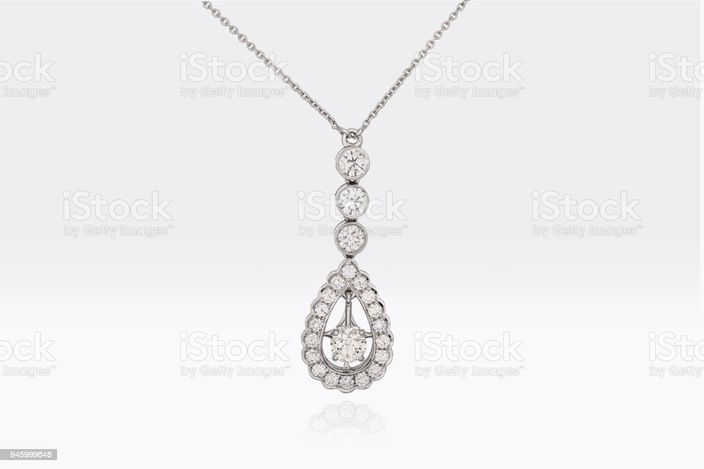 Close Up Of A Beautiful Round And Pear Shape Diamonds Pendant In White Platinum Gold Isolated On White Background stock photo