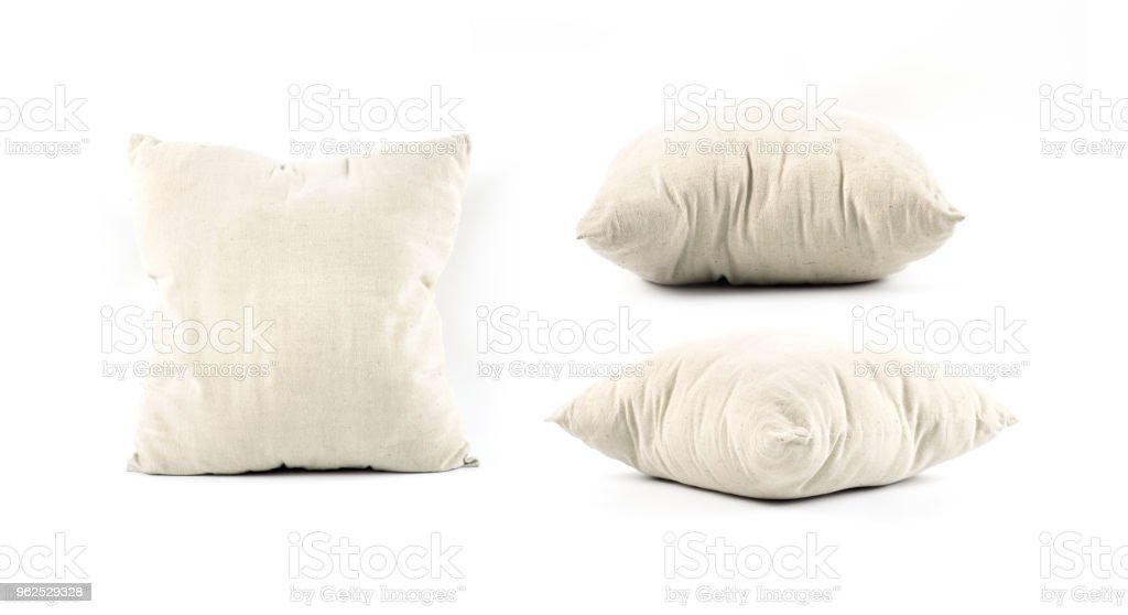close up of a beige pillow on white background - Royalty-free Bed - Furniture Stock Photo