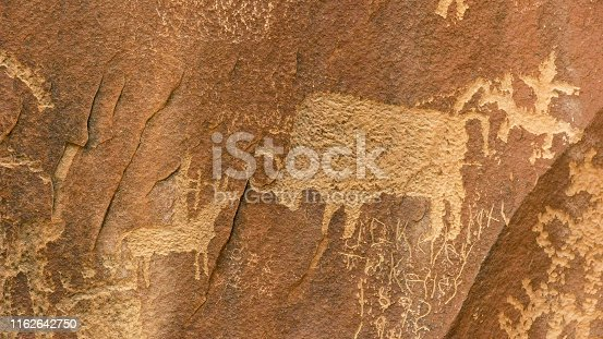close up of a bison hunting scene on newspaper rock at canyonlands national park in utah, usa