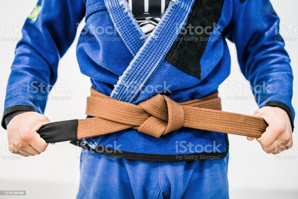 Close up of a bjj brown belt stock photo