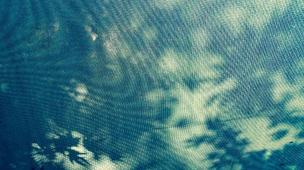 close up of a blue canopy fabric under the sun - cosmetique store photos et images de collection
