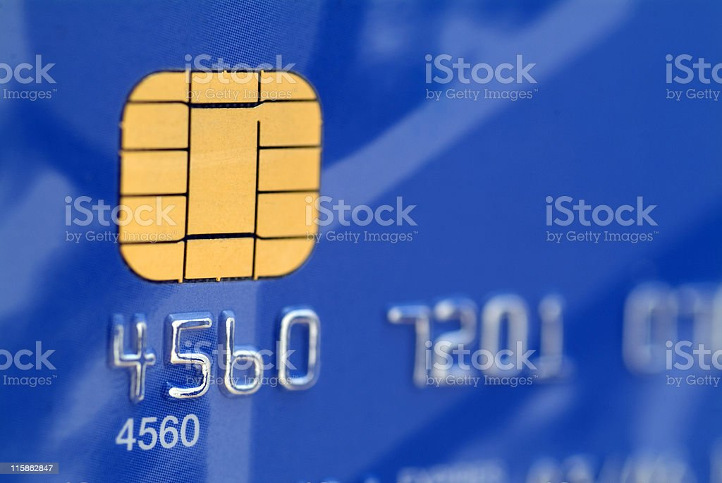 A close up of a blue credit card chip stock photo