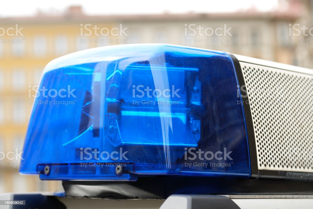 Close up of a blue police siren royalty-free stock photo