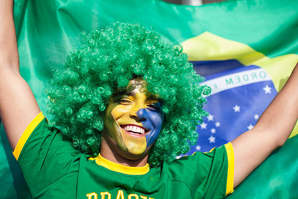 Close up of a Brazilian soccer supporter. stock photo