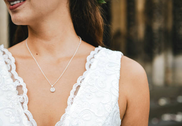 Close up of a bride with a diamond necklace stock photo