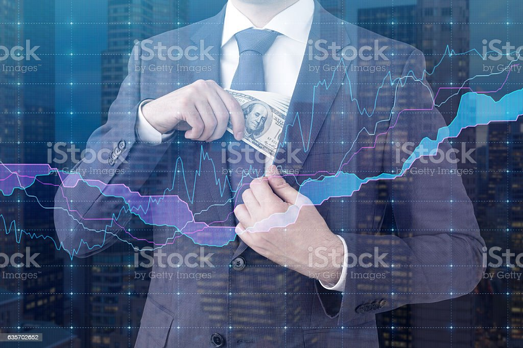 Close up of a broker with dollar bills and graphs royalty-free stock photo
