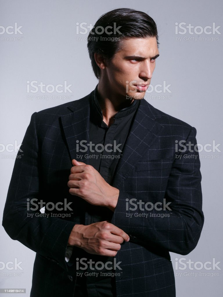 Close Up Of A Brutal Man In Elegant Suit Poses With Attitudine Looking In Profile Isolated In A White Background Stock Photo Download Image Now Istock
