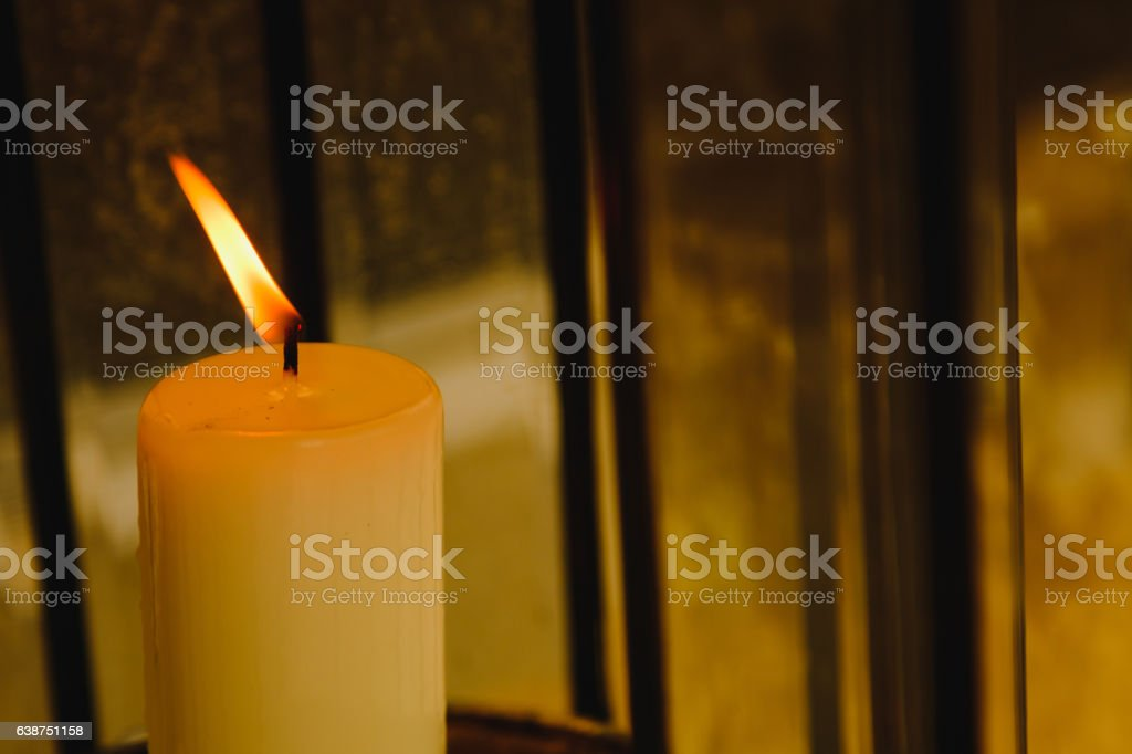 Close up of a burning candle flame stock photo