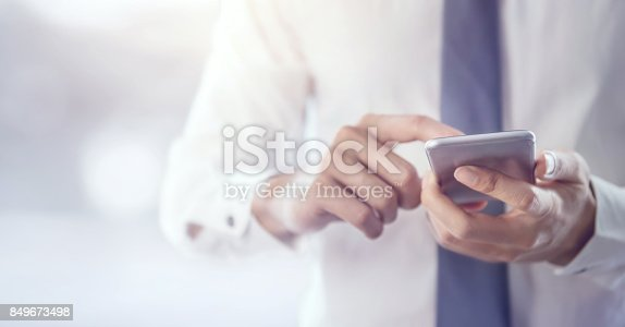 istock Close up of a business man using mobile smart phone. 849673498