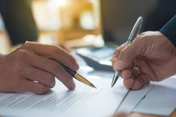 Close up of a business person who signs an agreement. Close up of a business person who signs an agreement. Concept of contract signing. dealing cards stock pictures, royalty-free photos & images