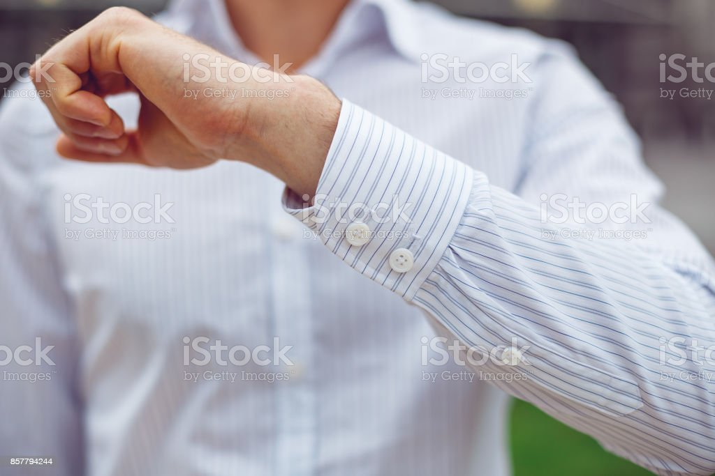 Close up of a businessman in a white shirt and shows the sleeve stock photo