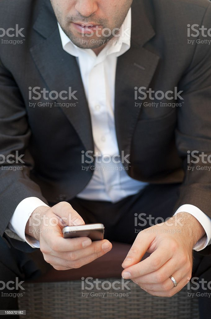 Close up of a businessman using smart phone royalty-free stock photo