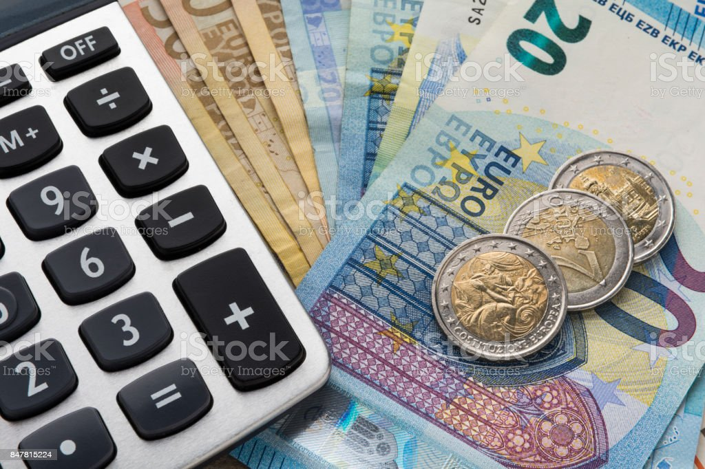 Close up of a calculator and euro money in a financial analyzing concept Close up of a calculator and euro money in a financial analyzing concept Abundance Stock Photo