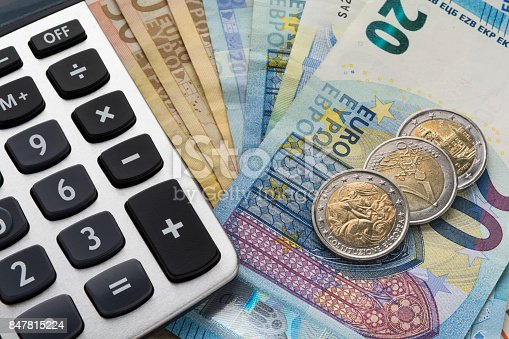 istock Close up of a calculator and euro money in a financial analyzing concept 847815224