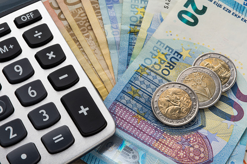 Close Up Of A Calculator And Euro Money In A Financial Analyzing Concept Stock Photo - Download Image Now