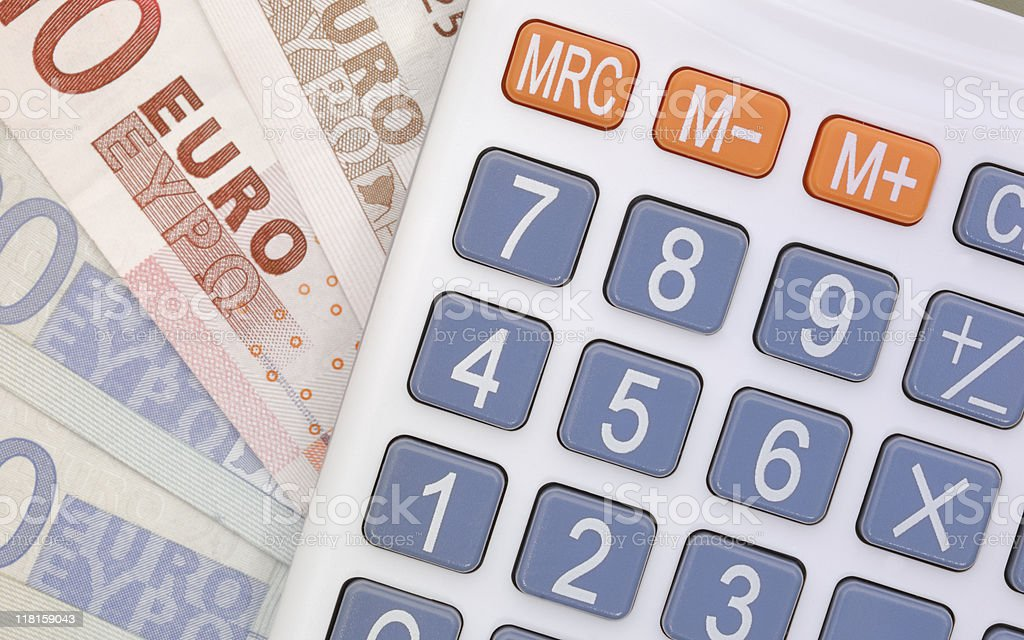 Close up of a calculator and Euro notes royalty-free stock photo