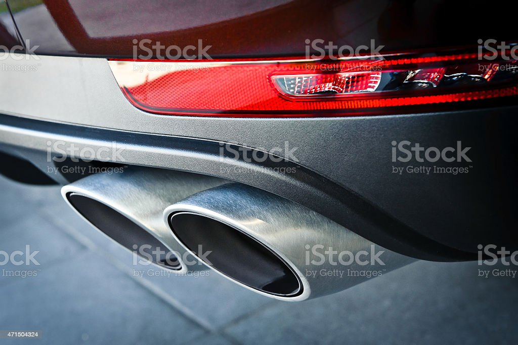 Close up of a car dual exhaust pipe stock photo