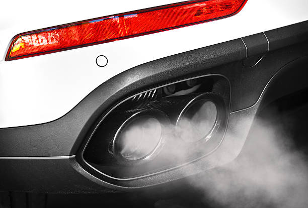 Close up of a car dual exhaust pipe Close up of a car dual exhaust pipe carbon dioxide stock pictures, royalty-free photos & images