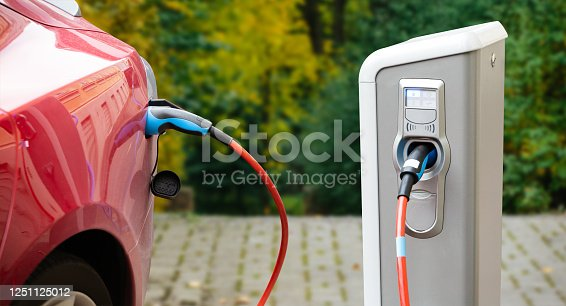 istock Close up of a charging electric car 1251125012