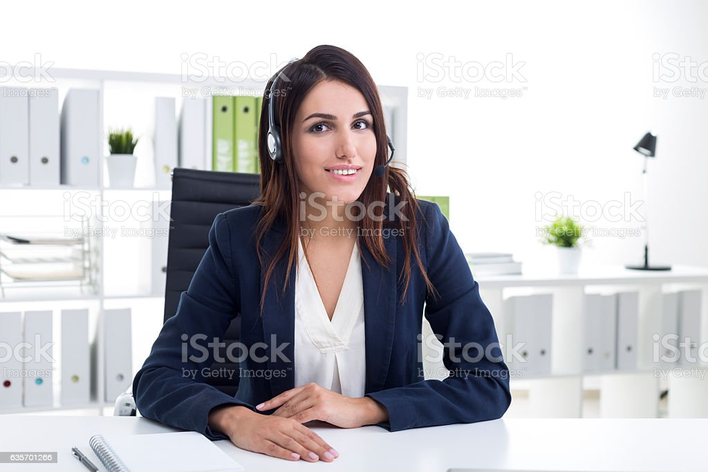Close up of a cheerful customer support dept employee royalty-free stock photo