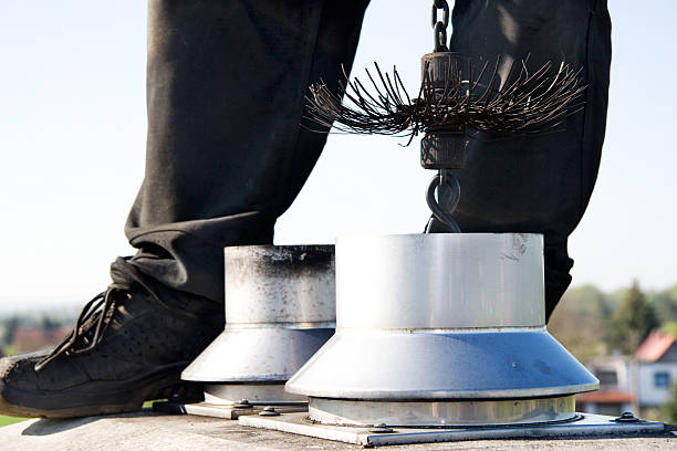 close up of a chimney sweep on the roof - sweeping stock pictures, royalty-free photos & images
