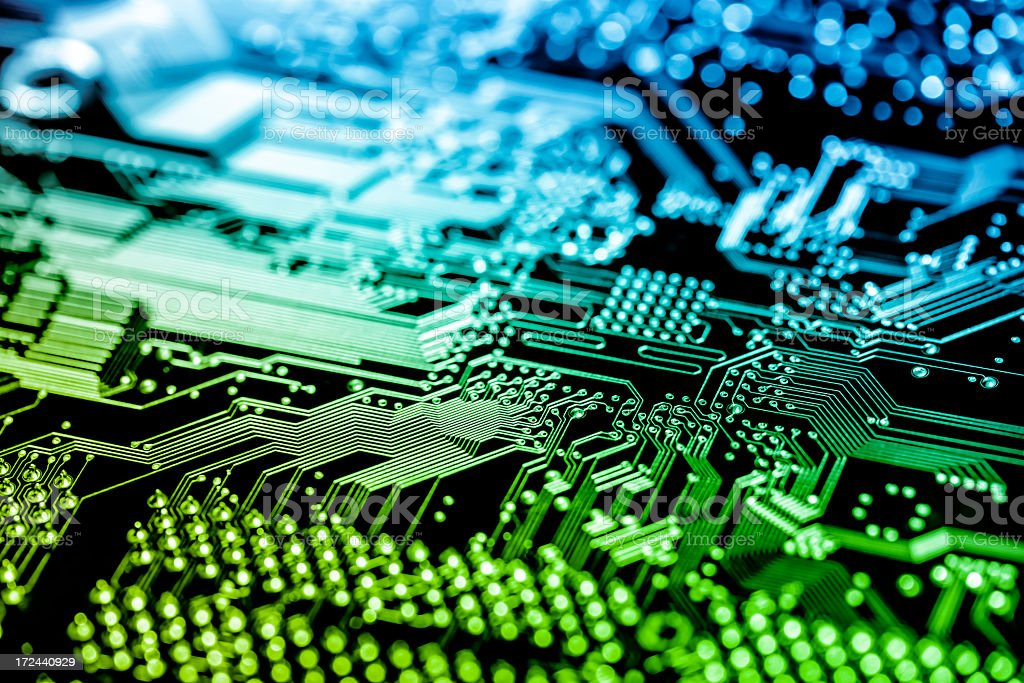 Close up of a circuit board in green and blue royalty-free stock photo