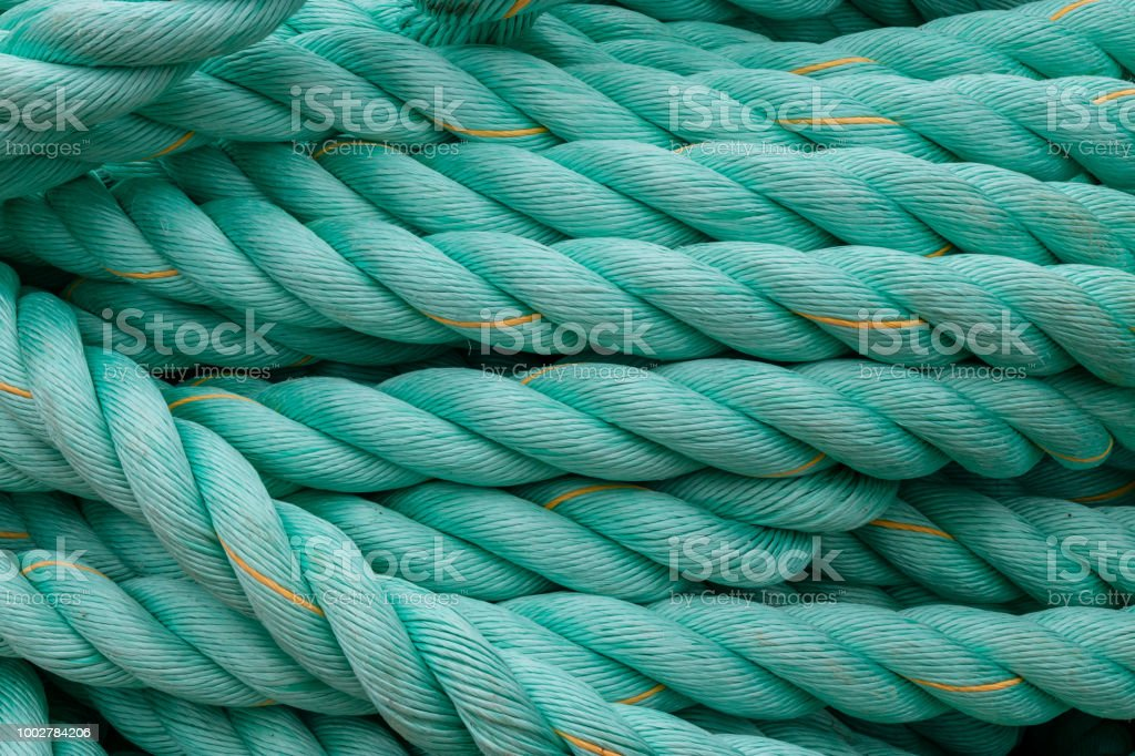 A close up of a coil of synthetic braided rope. stock photo