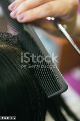 625205382 istock photo Close up of a comb brushing hair in a hairdressing 513817110