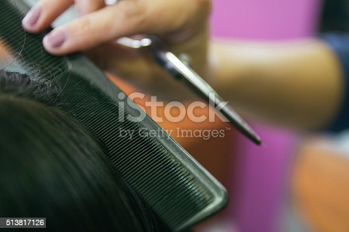 625205382 istock photo Close up of a comb brushing hair in a hairdressing 513817126