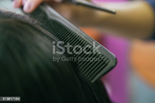625205382 istock photo Close up of a comb brushing hair in a hairdressing 513817154