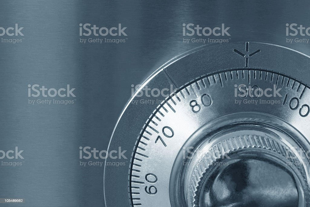 A close up of a combination lock on a safe stock photo