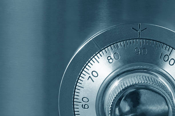 A close up of a combination lock on a safe Combination safe lock, close-up view, in cyan tone.   http://robynm.smugmug.com/photos/175514497-L.jpg  safe security equipment stock pictures, royalty-free photos & images