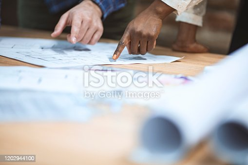 832105172 istock photo Close up of a coworkers working on a project. 1202944100