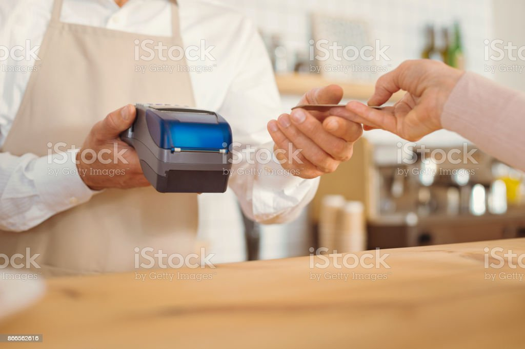 Close up of a credit card being used for payment stock photo