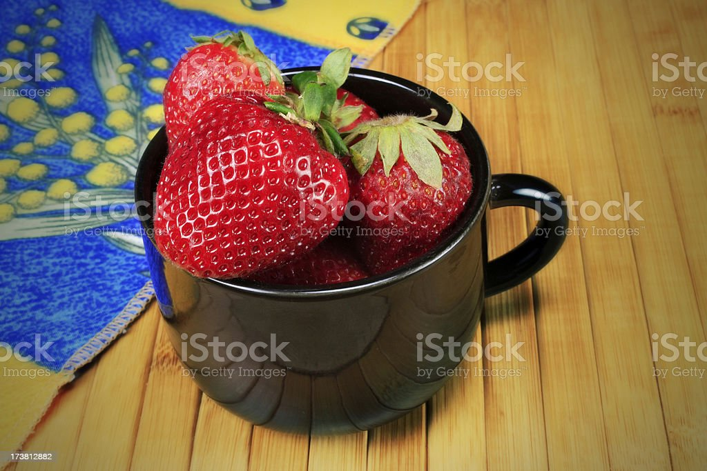 Close up of a Cup of Strawberries Effect royalty-free stock photo