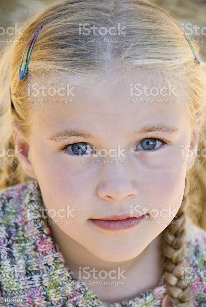 Close up of a cute little blond girl's face royalty-free stock photo
